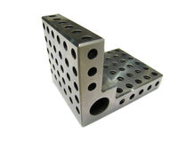 Angle plate. Picture of precision angle plate with threaded holes Stock Photos