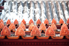 The angle pottery in Thai style decorate on the ancient roof of Royalty Free Stock Photos