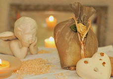 Angle of Relaxation. Bath salts soap candles and a ceramic white angle Royalty Free Stock Photos