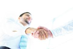Angle-shot of shake hands Royalty Free Stock Photos