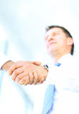 Angle-shot of shake hands Stock Photography
