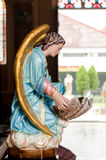 Angle statue in Chruch Stock Image