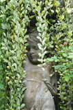 Angle stone sculpture decoration item in the garden with Dischid Royalty Free Stock Image