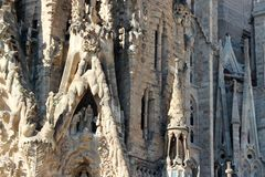 Fragment of two facades of La Sagrada Familia cathedral in Barcelona, Spain. The angle of the two facades of the Catholic Cathedral, made at different times and stock photo