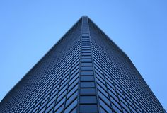 Angle view of a glass-windowed office tower. Angle view of a glass-windowed corporate tower stock photography