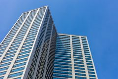 Angle view of high rise building in downtown Chicago with blue s. Ky background stock photos