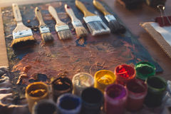 Angle view picture of an old palette with oil paints and gouache set. Clean painter workplace ready for drawing. Stock Photography
