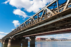 Angle view of a rusty bridge. Against blue sky stock photos