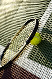 Angled Baseline. A closeup view, on an angle, of a tennis ball and racquet on the baseline of a tennis court royalty free stock photos