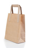 Angled brown paper bag Stock Images