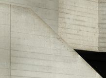 Angled cast concrete textured abstract with sloping surfaces Stock Image