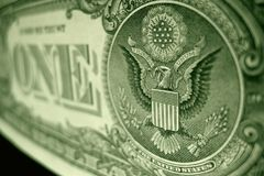 Angled, shallow focus shot of the great seal, on the American one dollar bill. stock photo