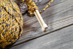 Angled closeup of bottom part of wooden Knitting needles Royalty Free Stock Image