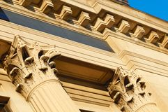 Angled columns. Angled detail of Corinthian style columns and cornice detail on a bank building Royalty Free Stock Image