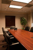 Angled Conference Room Table with Phone Royalty Free Stock Photography