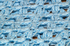 Angled detail view of blue crocheted afghan blanket Stock Photos