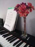 Digital Piano with Music Sheet and Vase of Flowers royalty free stock image