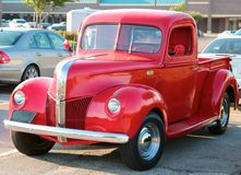 Angled front view of a 1940's model red Ford 3100 pick-up truck. Royalty Free Stock Photos