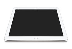 Angled front view of white tablet pc with blank screen mockup li Stock Images