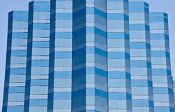 Angled Glass Building of Blue and Grey Stripes Stock Image