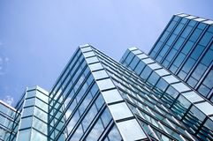 Angled glass office building Stock Image