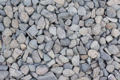 Angled Gravels of Gray Color with Some Rusty Stains. Background of Angled Gravels of Gray Color with Some Rusty Stains Stock Photography