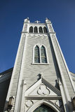 Angled View of Church Steeple against Deep Blue Sky Stock Photo