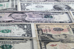 Angled Money. Background of various US dollar bills at an angle Stock Photography
