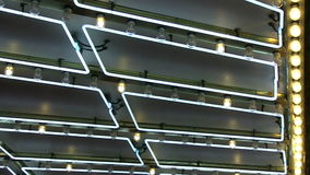 Angled Neon Marquee and Chasing Light Loop. An above view of neon and chasing lights from a vintage marquee stock footage