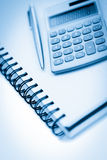 Angled notebook with pencil and pocket calculator Royalty Free Stock Images