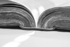 Angled open book, detailing spine and page edge. An angled shot of an old open book, detailing the spine and page edges Royalty Free Stock Photos