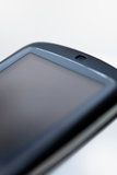 Angled PDA. An angled view of an HTC Touch PDA device, isolated Royalty Free Stock Image