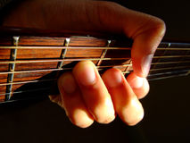 Guitar chord. A mans hand holding a major chord on an acoustic guitar Royalty Free Stock Photo