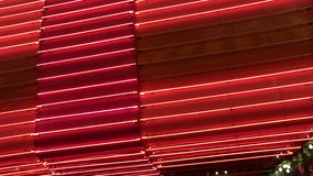 Angled Red Neon Wall Loop. An abstract and blank loop of chasing red neon stock video