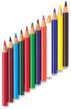 Angled row of childrens colouring coloring pencils. An angled row of childrens colouring coloring pencils on a white background Royalty Free Stock Photos