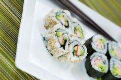 Angled shot of Handmade Sushi on serving plate Stock Image