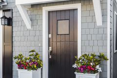 Angled view of black front door to home Royalty Free Stock Photos