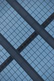 Angled view of blue glass building facade Stock Photography