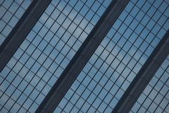 Angled view of blue glass skyscraper facade Stock Images