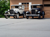 Angled View of Classic Sedans. Angled front view of a pair of classic sedan autos Stock Image