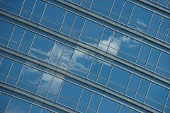 Angled view of cloud reflected in windows Stock Photos