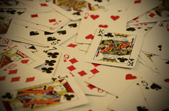 Angled View of Playing Cards Scattered on a Table Stock Image
