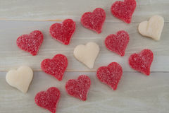 Angled View of Red and White Gummy Hearts Lined Up Stock Photo