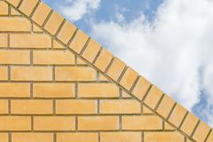 Angled wall. Modern clean brickwork angled wall with sky in the background Stock Photos