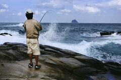 Angler. On the rocky shore anglers fishing Royalty Free Stock Photos