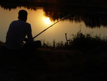 Angler. On the river stock photo
