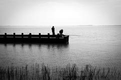 Angler auf dem prier Stockfotos