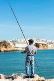 Angler on autumn sea coast Royalty Free Stock Photo