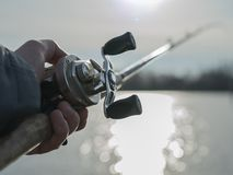 Angler with baitcasting reel in hilights Royalty Free Stock Images
