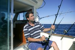 Angler big game saltwater fisher boat royalty free stock photo